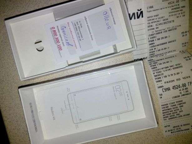 коробка от смартфона и чек о покупке